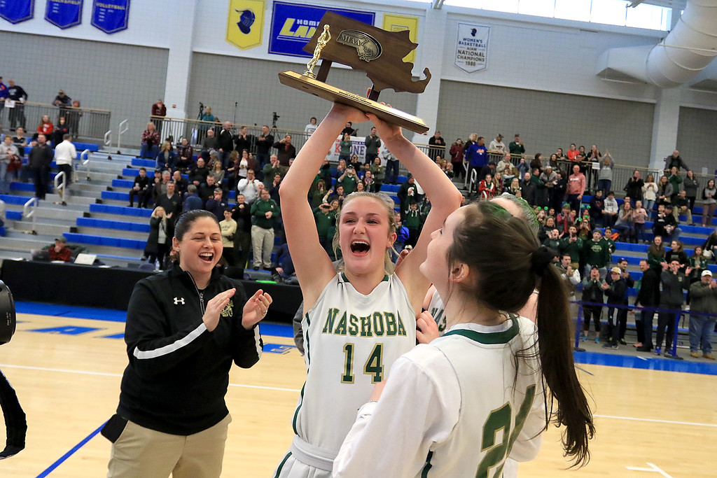 . Nashoba Regional High School beat Groton Dunstable Regional High School on Saturday, March 9, 2019 during the Girls Division II Championship game at Worcester State University. NRHS\'s Julia Roth hold up the trophy over her head.  SENTINEL & ENTERPISE/JOHN LOVE