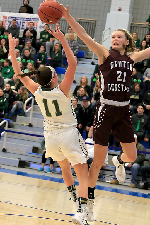 . Nashoba Regional High School beat Groton Dunstable Regional High School on Saturday, March 9, 2019 during the Girls Division II Championship game at Worcester State University. GDRHS\'s Bronwyn Mulligan tries to block a shot by NRHS\'s Abigail McNulty. SENTINEL & ENTERPISE/JOHN LOVE