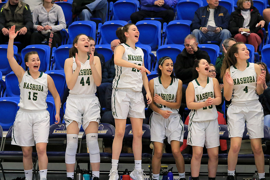 . Nashoba Regional High School beat Groton Dunstable Regional High School on Saturday, March 9, 2019 during the Girls Division II Championship game at Worcester State University. Nashoba players on the bench cheer for a basket early in the game. SENTINEL & ENTERPISE/JOHN LOVE
