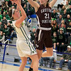 Nashoba Regional High School beat Groton Dunstable Regional High School on Saturday, March 9, 2019 during the Girls Division II Championship game at Worcester State University. GDRHS's Bronwyn Mulligan tries to block a shot by NRHS's Abigail McNulty. SENTINEL & ENTERPISE/JOHN LOVE
