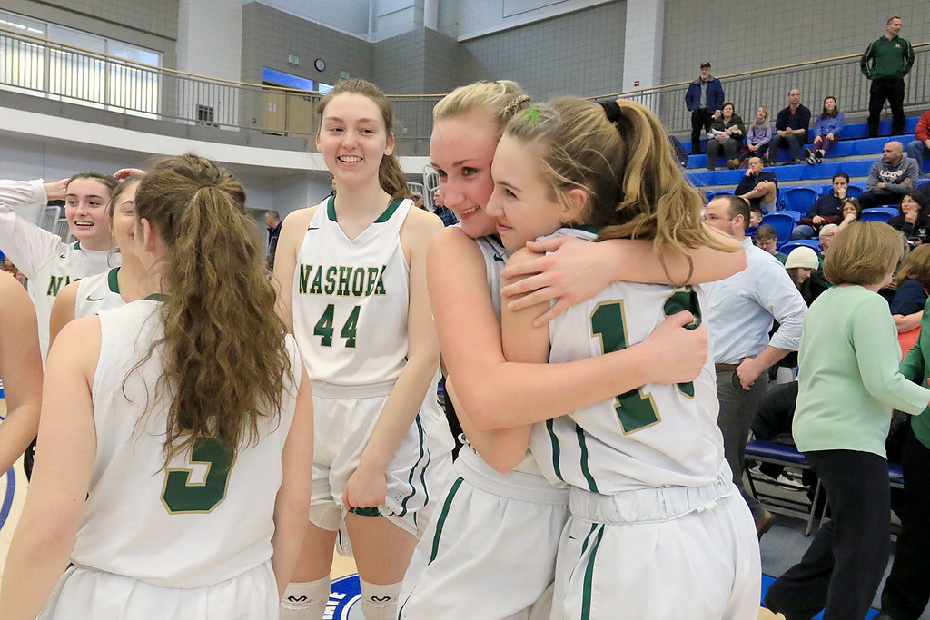. Nashoba Regional High School beat Groton Dunstable Regional High School on Saturday, March 9, 2019 during the Girls Division II Championship game at Worcester State University. NRHS teammates Julia Roth Jillian Payne hug as they celebrate their win. SENTINEL & ENTERPISE/JOHN LOVE