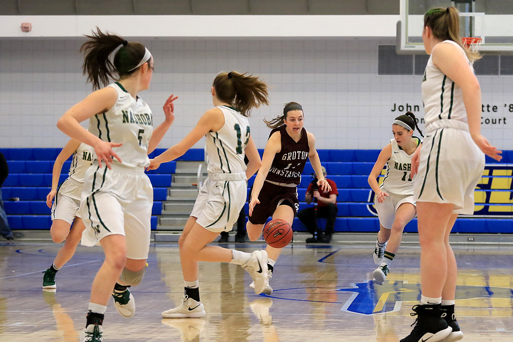 . Nashoba Regional High School beat Groton Dunstable Regional High School on Saturday, March 9, 2019 during the Girls Division II Championship game at Worcester State University.  GDRHS\'s Hannah Wynn gets control of the ball and takes it down court early in the game. SENTINEL & ENTERPISE/JOHN LOVE