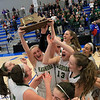 Nashoba Regional High School beat Groton Dunstable Regional High School on Saturday, March 9, 2019 during the Girls Division II Championship game at Worcester State University. NRHS celebrates with the trophy. Nashoba won the game, 44-43.  SENTINEL & ENTERPISE/JOHN LOVE