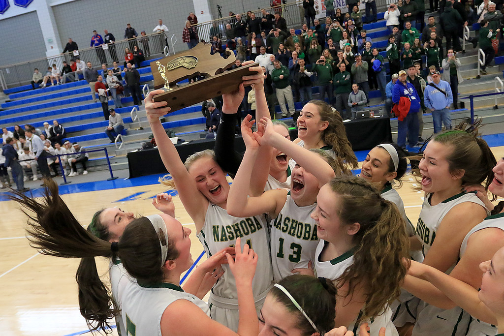 . Nashoba Regional High School beat Groton Dunstable Regional High School on Saturday, March 9, 2019 during the Girls Division II Championship game at Worcester State University. NRHS celebrates with the trophy. Nashoba won the game, 44-43.  SENTINEL & ENTERPISE/JOHN LOVE