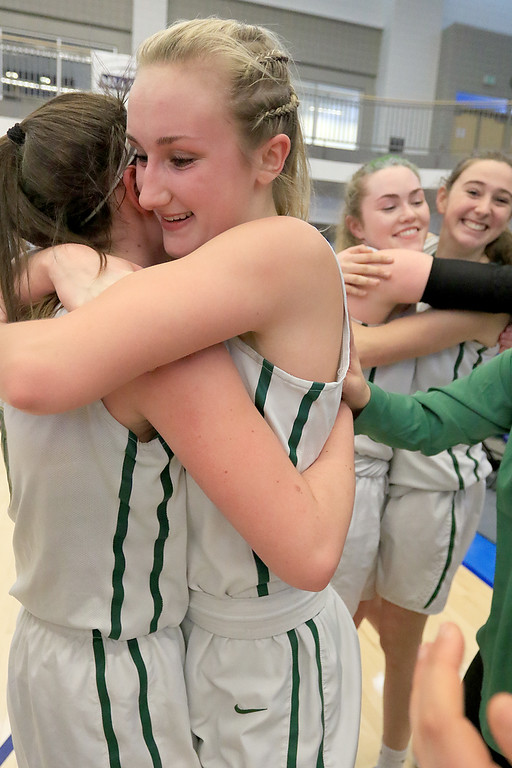 . Nashoba Regional High School beat Groton Dunstable Regional High School on Saturday, March 9, 2019 during the Girls Division II Championship game at Worcester State University. Teammates Alexis Richard and Julia Roth hug as they celebrate their win. SENTINEL & ENTERPISE/JOHN LOVE