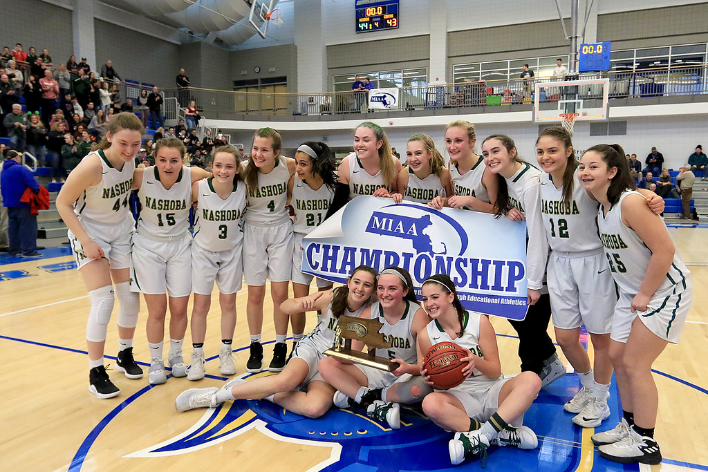 . Nashoba Regional High School beat Groton Dunstable Regional High School on Saturday, March 9, 2019 during the Girls Division II Championship game at Worcester State University. NRHS team poses with the trophy. SENTINEL & ENTERPISE/JOHN LOVE