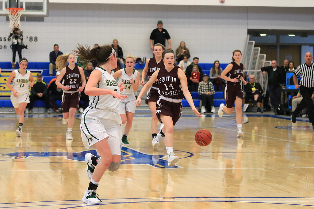 . Nashoba Regional High School beat Groton Dunstable Regional High School on Saturday, March 9, 2019 during the Girls Division II Championship game at Worcester State University. GDRHS\'s Hannah Wynn charges down court with the ball. SENTINEL & ENTERPISE/JOHN LOVE