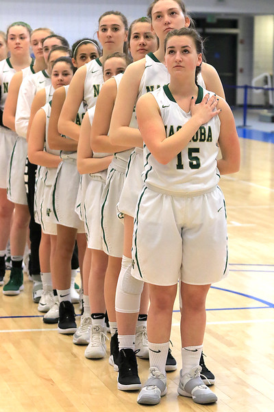 Nashoba Regional High School beat Groton Dunstable Regional High School on Saturday, March 9, 2019 during the Girls Division II Championship game at Worcester State University. Nashboa girls stand for the national anthem at the start of the game. SENTINEL & ENTERPISE/JOHN LOVE