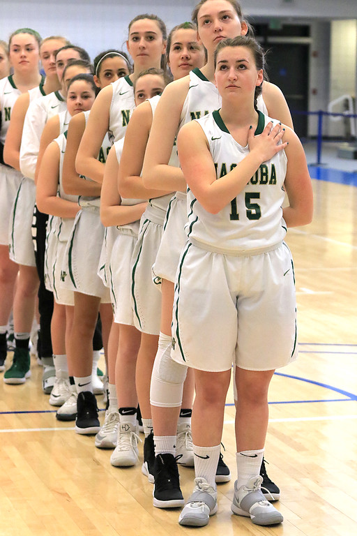 . Nashoba Regional High School beat Groton Dunstable Regional High School on Saturday, March 9, 2019 during the Girls Division II Championship game at Worcester State University. Nashboa girls stand for the national anthem at the start of the game. SENTINEL & ENTERPISE/JOHN LOVE