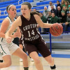 Nashoba Regional High School beat Groton Dunstable Regional High School on Saturday, March 9, 2019 during the Girls Division II Championship game at Worcester State University. GDRHS's  Hannah Wynn tries to get by NRHS's Abigail McNulty as she charges to the net. SENTINEL & ENTERPISE/JOHN LOVE