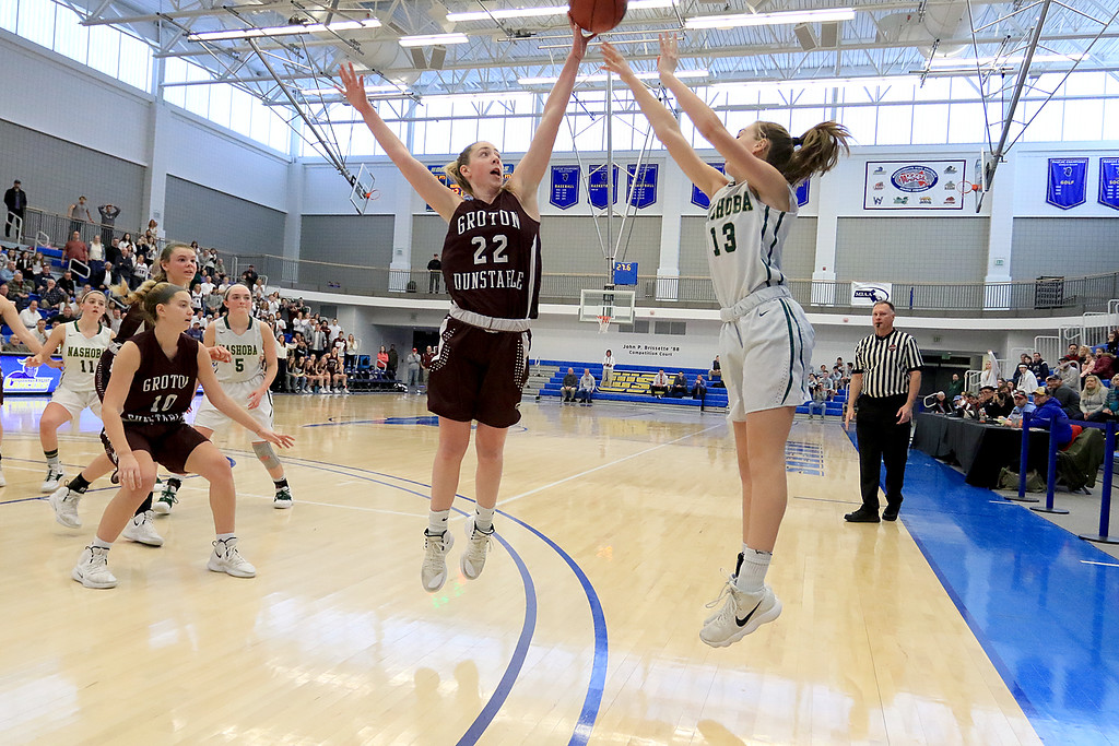 . Nashoba Regional High School beat Groton Dunstable Regional High School on Saturday, March 9, 2019 during the Girls Division II Championship game at Worcester State University. GDRHS\'s Jillian Van Pelt tries to block a three point shot by NRHS\'s Jillian Payne. SENTINEL & ENTERPISE/JOHN LOVE