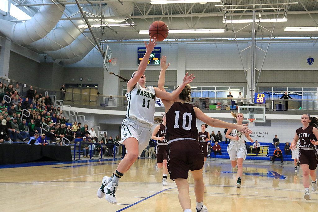 . Nashoba Regional High School beat Groton Dunstable Regional High School on Saturday, March 9, 2019 during the Girls Division II Championship game at Worcester State University. NRHS\'s Abigail McNulty puts up a shot over GDRHS\'s Emily Smith. SENTINEL & ENTERPISE/JOHN LOVE
