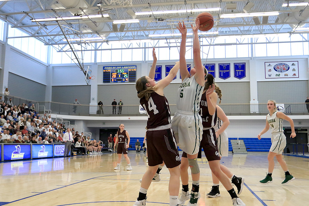 . Nashoba Regional High School beat Groton Dunstable Regional High School on Saturday, March 9, 2019 during the Girls Division II Championship game at Worcester State University. NRHS\'s Alexis Richard gets fouled by GDRHS\'s Hannah Wynn as she tries to get off a shot. SENTINEL & ENTERPISE/JOHN LOVE