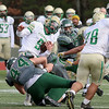 Nashoba Regional High School player Kyle Hume takes down Clinton High Schools Trevor Burton with help from teammates during the Thanksgiving Day game. SENTINEL & ENTERPRISE/JOHN LOVE