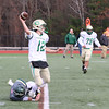 Nashoba Regional High School player Max Parrow wraps up the legs of Clinton High School quarterback Jack McEvilly as he tried to throw the ball during the Thanksgiving Day game. SENTINEL & ENTERPRISE/JOHN LOVE