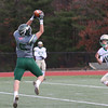 Nashoba Regional High School player Breese Hill makes a nice catch and some nice moves to get by two Clinton High Schools players #5 Trevor Burton and #12 Jack McEvilly to score a touchdown during the Thanksgiving Day game. SENTINEL & ENTERPRISE/JOHN LOVE