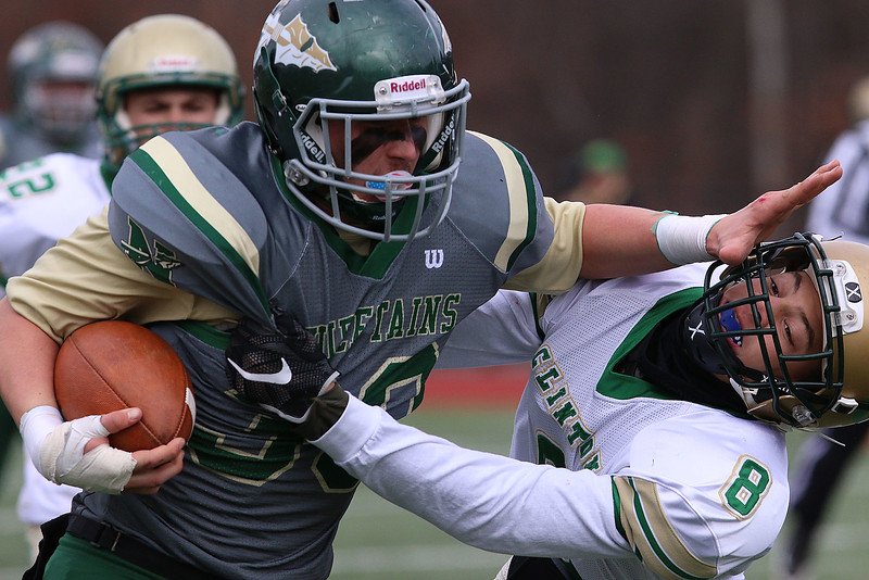 Nashoba Regional High School player Luke Danby stiff arms Clinton High Schools Brevin Cassella as he runs with the ball late in the Thanksgiving Day game on Thursday, Nov. 23, 2016. Nashoba won, 41-6. SENTINEL & ENTERPRISE/JOHN LOVE