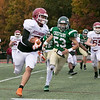 Nashoba Regional High School played Fitchburg High School on Friday afternoon in Bolton. NRHS's #53 Chad Hinckley chases down FHS's #7 Anthony Oquendo. SENTINEL & ENTERPRISE/JOHN LOVE