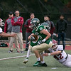 Nashoba Regional High School played Fitchburg High School on Friday afternoon in Bolton. FHS's #42 Nate Acker tries to stop NRHS's #10 Jack Bonazzoli. SENTINEL & ENTERPRISE/JOHN LOVE
