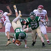 Nashoba Regional High School played Fitchburg High School on Friday afternoon in Bolton. FHS's #22 Gabriel Rivera upends NRHS's #22 Aidan Lee during action in the second half. SENTINEL & ENTERPRISE/JOHN LOVE
