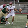 Nashoba Regional High School played Fitchburg High School on Friday afternoon in Bolton. NRHS's #77 Joe Flannery gets ready to tackle FHS's QB #1 Montgomery Graham as he looks for some one to pass to. SENTINEL & ENTERPRISE/JOHN LOVE