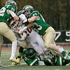 Nashoba Regional High School played Fitchburg High School on Friday afternoon in Bolton. FHS's #20 Bryan Rivera gets tackled by NRHS's #22 Aidan Lee and #63 Will O'Shea. SENTINEL & ENTERPRISE/JOHN LOVE