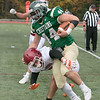 Nashoba Regional High School played Fitchburg High School on Friday afternoon in Bolton. NRHS's #44 Connor Salmon gets by FHS's #7 Anthony Oquendo on his way to a touch down. SENTINEL & ENTERPRISE/JOHN LOVE