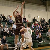 Nashoba Regional High School boys basketball played Groton Dunstable Regional High School on Tuesday night in Bolton. GDRHS's #4 Kyle Plausee and NRHS's #14 Joey Sabourin. SENTINEL & ENTERPRISE/JOHN LOVE