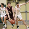 Nashoba Regional High School boys basketball played Groton Dunstable Regional High School on Tuesday night in Bolton. GDRHS's #12 Charlie Willis and NRHS's #2 Andrew Dray chase down a loose ball. SENTINEL & ENTERPRISE/JOHN LOVE
