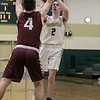 Nashoba Regional High School boys basketball played Groton Dunstable Regional High School on Tuesday night in Bolton. GDRHS's #4 Kyle Plausse covers NRHS's #2 Andrew Dray. SENTINEL & ENTERPRISE/JOHN LOVE