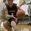 Nashoba Regional High School boys basketball played Groton Dunstable Regional High School on Tuesday night in Bolton. GDRHS's #4 Kyle Plausse is covered by NRHS's #1 Jacob Belsanti. SENTINEL & ENTERPRISE/JOHN LOVE
