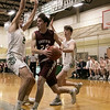Nashoba Regional High School boys basketball played Groton Dunstable Regional High School on Tuesday night in Bolton. NRHS's #2 Andrew Dray covers GDRHS's #24 Joe O'Malley as he drives to the basket. SENTINEL & ENTERPRISE/JOHN LOVE