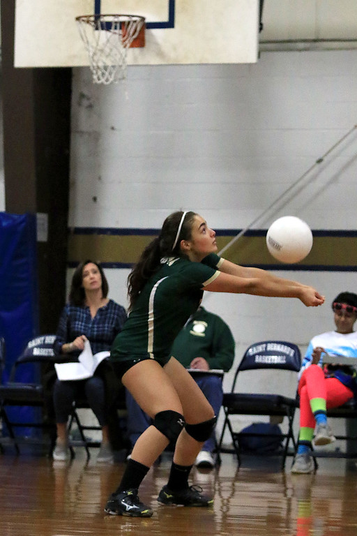 . Nashoba Regional High School volleyball traveled to Fitchburg to play St. Bernard\'s Central Catholic High School on Wednesday afternoon, October 17, 2018. NRHS\'s Noroian Sophia sets the ball. SENTINEL & ENTERPRISE/JOHN LOVE