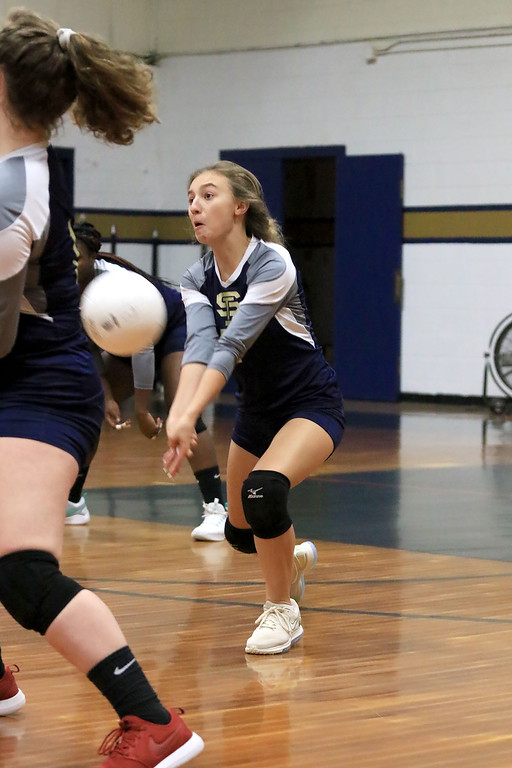 . Nashoba Regional High School volleyball traveled to Fitchburg to play St. Bernard\'s Central Catholic High School on Wednesday afternoon, October 17, 2018. St. B\'s Olivia Harrison goes after the ball during action in the game. SENTINEL & ENTERPRISE/JOHN LOVE