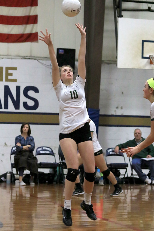 . Nashoba Regional High School volleyball traveled to Fitchburg to play St. Bernard\'s Central Catholic High School on Wednesday afternoon, October 17, 2018. NRHS\'s Jane Keaveney sets the ball.  SENTINEL & ENTERPRISE/JOHN LOVE