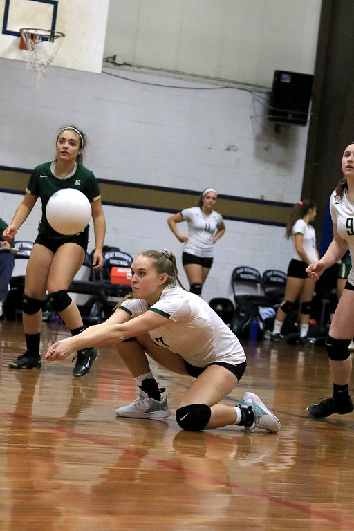 . Nashoba Regional High School volleyball traveled to Fitchburg to play St. Bernard\'s Central Catholic High School on Wednesday afternoon, October 17, 2018. NRHS\'s Alexa Konstantinidis digs the ball. SENTINEL & ENTERPRISE/JOHN LOVE
