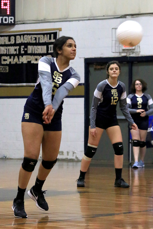 . Nashoba Regional High School volleyball traveled to Fitchburg to play St. Bernard\'s Central Catholic High School on Wednesday afternoon, October 17, 2018. St. B\'s Akshara Challa goes after a serve during action in the game. SENTINEL & ENTERPRISE/JOHN LOVE