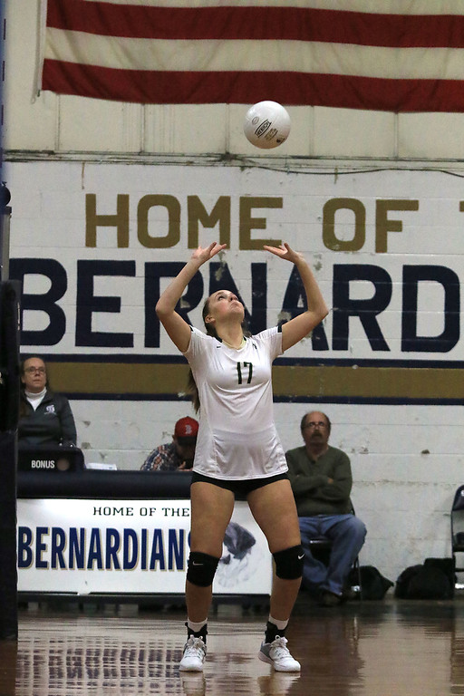 . Nashoba Regional High School volleyball traveled to Fitchburg to play St. Bernard\'s Central Catholic High School on Wednesday afternoon, October 17, 2018. NRHS\'s Alexa Konstantinidis sets the ball.  SENTINEL & ENTERPRISE/JOHN LOVE