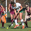 Nashoba Regional High School field hockey played Algonquin Regional High School on Saturday, Nov. 9, 2019 for the Central Mass. Division 1 championship. NRHS's #24 Gillian Fay between ARHS's #7 Alexandria Moll, on left, and #13 Sabrina Ferro.  SENTINEL & ENTERPRISE/JOHN LOVE