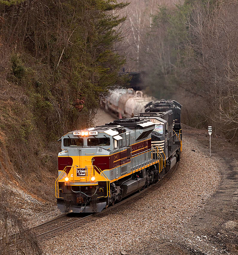 NS train 135 with Delaware Lackawanna and Western RR Heritage motor #1074 from the Old Hwy 70 bridge west of Old Fort,NC.