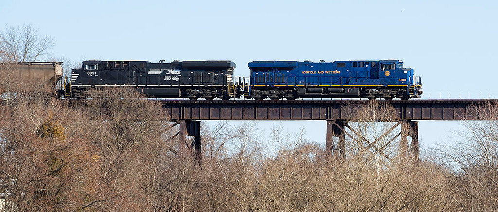 Norfolk & Western Ry Heritage motor NS 8103 leads a southbound corn train over the Salem Creek trestle on the Winston-Salem Southbound Ry in Winston-Salem,NC.