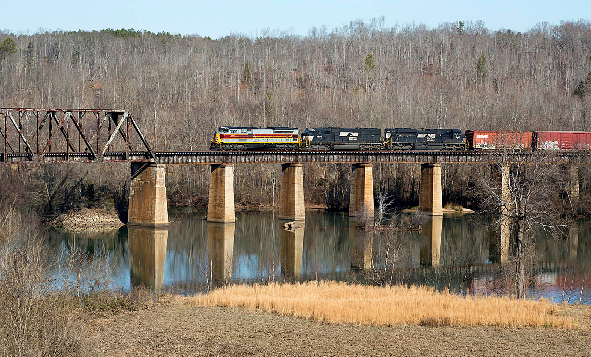 NS train 135 with Delaware Lackawanna and Western RR Heritage motor #1074 in the lead crossing the Catawba River at Catawba,NC.