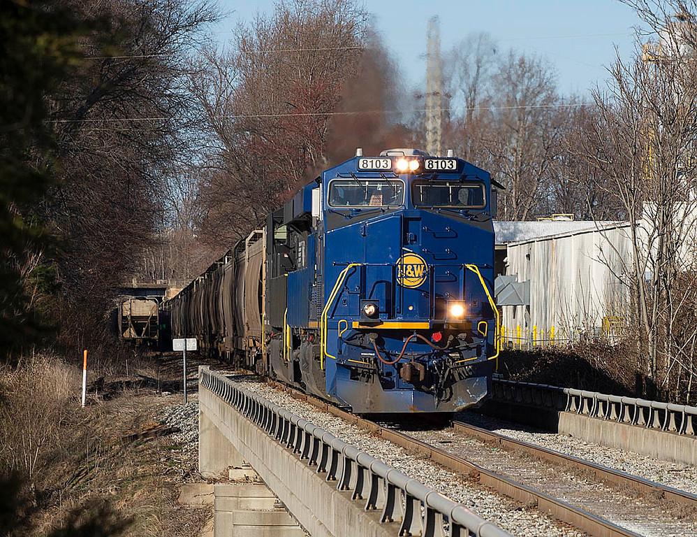 Norfolk & Western Ry Heritage motor NS 8103 leads a southbound corn train on the Winston-Salem Southbound Ry in Winston-Salem,NC.