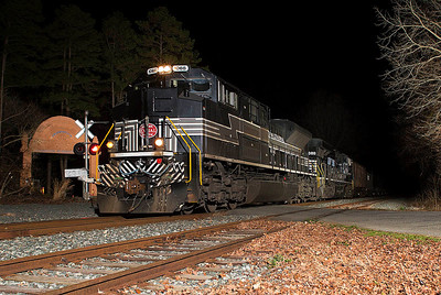 New York Central RR Heritage motor NS 1066 leads an empty ethanol train on the Winston-Salem Southbound Ry passing the Lexington Buddhist Temple near Cotton Grove,NC.