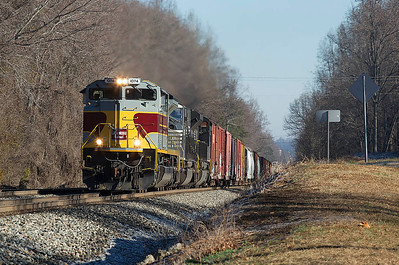 NS train 135 with Delaware Lackawanna and Western RR Heritage motor #1074 in the lead climbing Yadkin Hill at Spencer,NC.