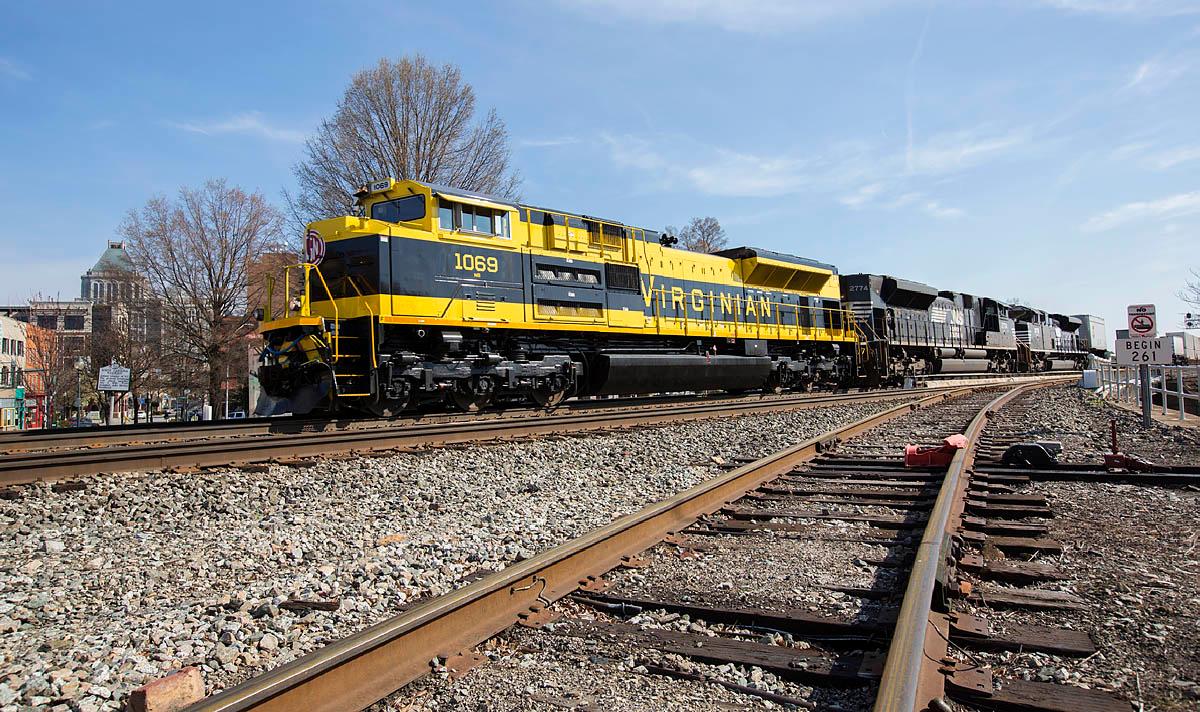 Virginian RR Heritage motor NS 1069 leading NS intermodal train 218 thru downtown Greensboro,NC.