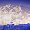 "PURPLE DENALI: ""The Great One"" Denali or Mt McKinley as it is know here in Alaska, wrapped in a scarf of clouds."