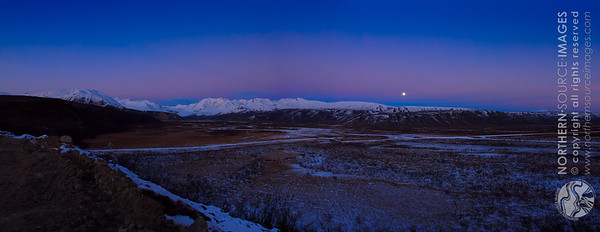 Home to Arctic Man with the mountains of the Alaskan Range in the background, with the rising moon above shortly after sunset in late October. COPYRIGHT NORTHERN SOURCE IMAGES © 2012