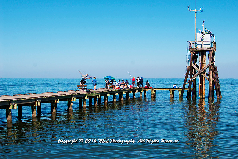 Time for fishing on the wharf, on Daulphin Island, in the shadow of Fort Gaines, in sight of off shore oil wells.