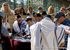 Bar Mitzvah at the Western Wall in Jerusalem, Israel, with the women of the Bar Mitzvah looking on from over the separation wall